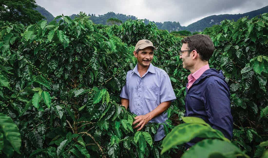 Emilio speaking with a farmer